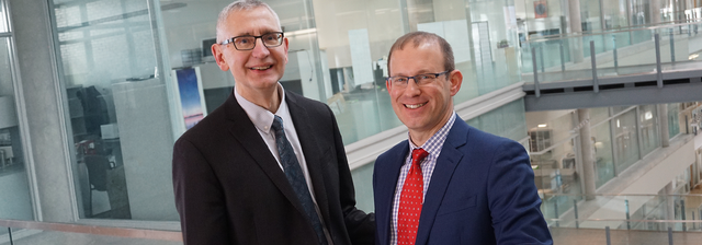 Dr. Vic Adamowicz, outgoing Research Director, with Dr. Eran Kaplinsky, incoming Research Director.